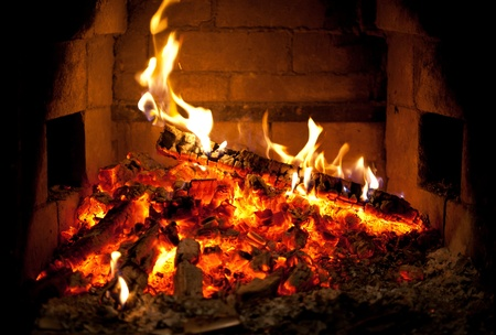 burning fire in the fireplace photo