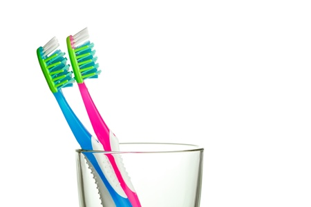 two toothbrushes in the glass with copy-space photo