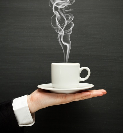 hand holding a cup with hot coffee photo