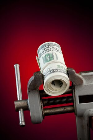 low budget concept - money in the vice tool photo