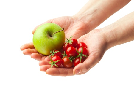 hand holding fresh apple and tomatoes, isolated on white background photo
