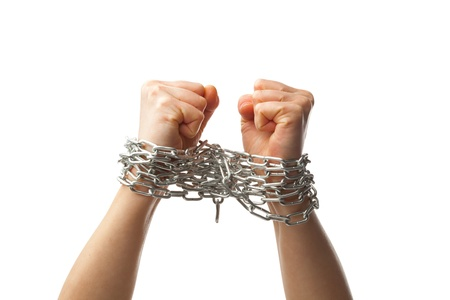 constraint: two chained fists, isolated on white background Stock Photo