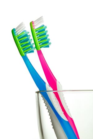two toothbrushes in the glass isolated Stock Photo - 8939737