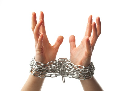 constraint: two chained hands, isolated on white background