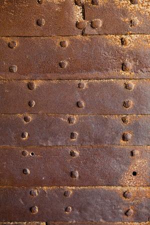 oxidized: antiguo fondo de remaches oxidado Foto de archivo