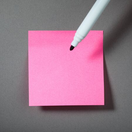 pink sticky paper and soft-tip pen photo