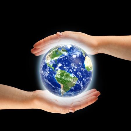 hands around globe photo