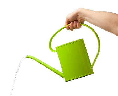 watering can: hand holding watering can isolated on white Stock Photo