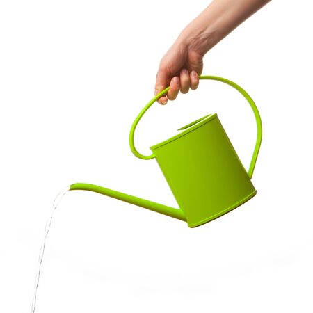 indoor plants: hand holding watering can isolated
