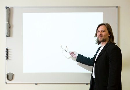 man makeing a presentation with empty projector screen Stock Photo - 9435212