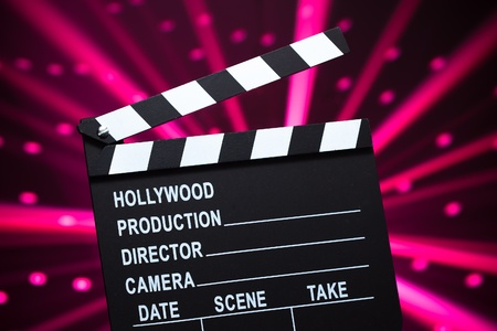 clapperboard on shiny background photo