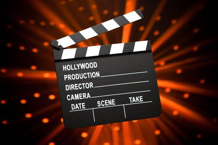 clapperboard against shiny background photo
