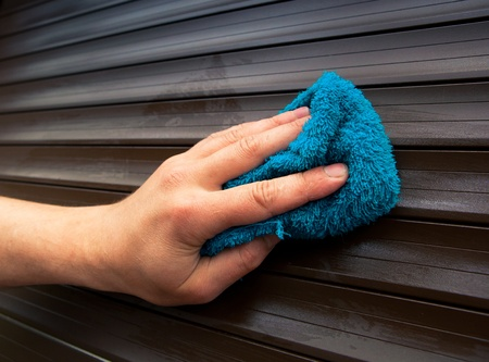 hand cleaning roller shutters photo