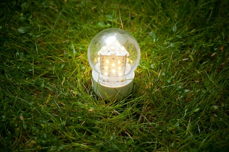 modern lamp: led lamp on the green grass