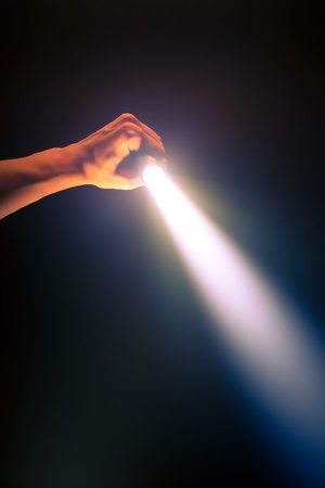 hand holding glowing pocket torch light photo