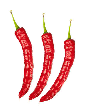 three red chili peppers, isolated on white photo