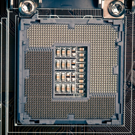 cpu processor socket pins on motherboard, macro view photo