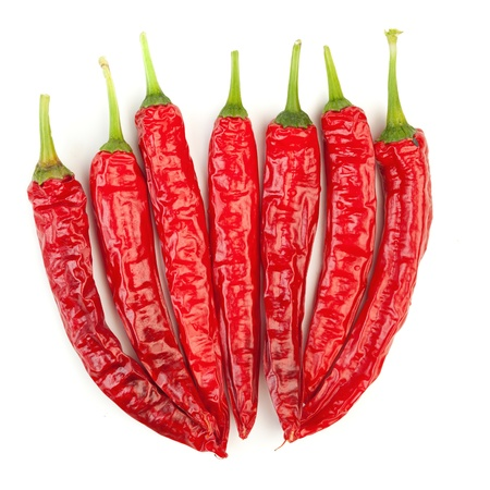 group of chili peppers, isolated on white photo