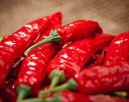 spicy chilli: multitude of red chili peppers, closeup view