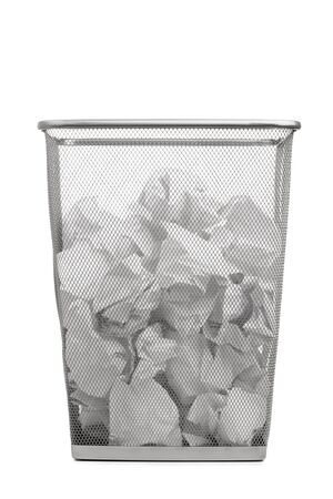 waste basket: office trash can with crumpled paper, isolated on white