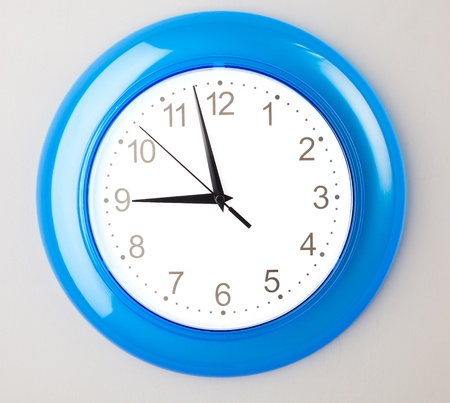 blue office clock on grey wall photo