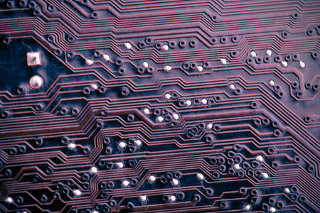 purple printed circuit board tracks, macro view photo