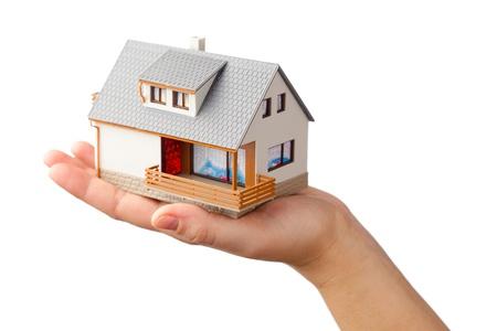 rental house: casa en la mano, aislados en blanco