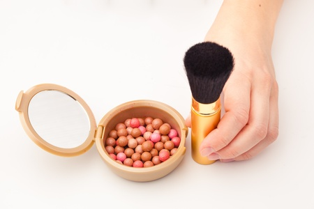 makeup brush and rouge, white background photo