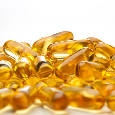 doses: omega-3 fish fat oil capsules, isolated on a white Stock Photo