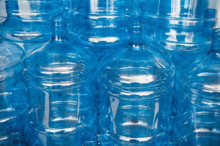 cooler: big empty water bottles at warehouse