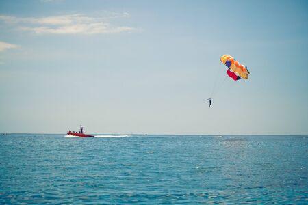 parasailing: parasailing above the blue sea