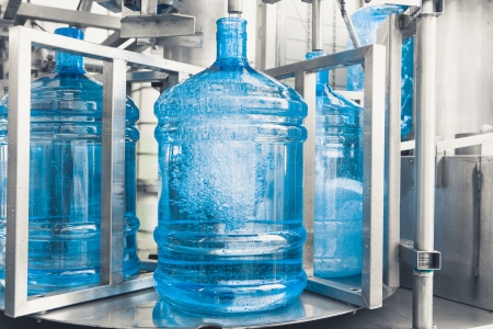 filling bottles: drink water production line Stock Photo