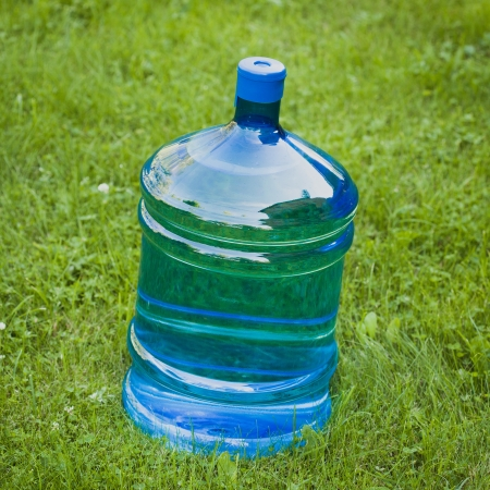 water big bottle on green grass background photo