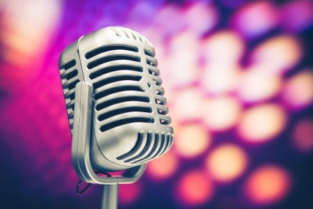 retro microphone on purple disco background Stock Photo - 14587802
