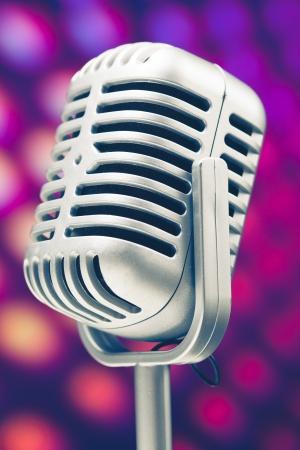 microphone retro on purple disco background photo