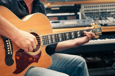 recording studio: man playing guitar, close-up