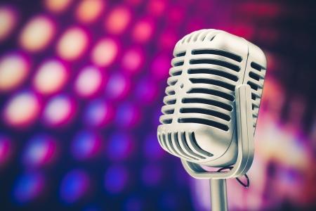 retro microphone on purple disco background photo