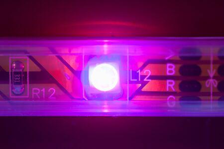 emit: purple led light, macro view