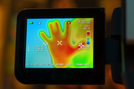 detect: display of noncontact infrared thermometer camera Stock Photo