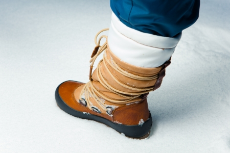 winter shoe in snow, close-up photo