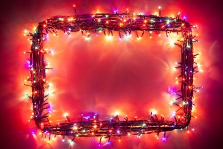 red christmas lights: christmas lights frame Stock Photo