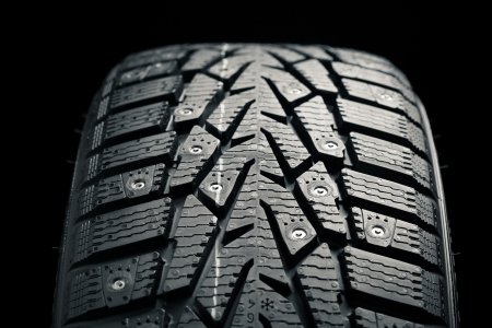 protector and snow spikes of winter tire Stock Photo - 16698911