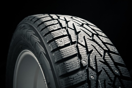 part of winter tire on black Stock Photo - 16698777
