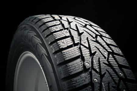 vulcanization: part of winter tire on black