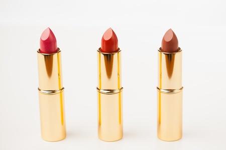 lipstick tube: three lipsticks on white background
