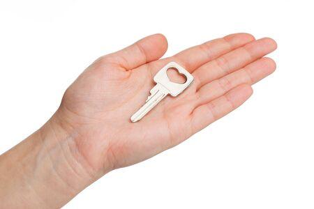 housewarming: key on a human palm isolated on white