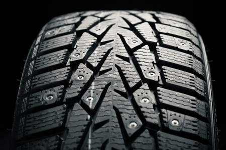 vulcanization: protector and snow spikes of winter tire Stock Photo
