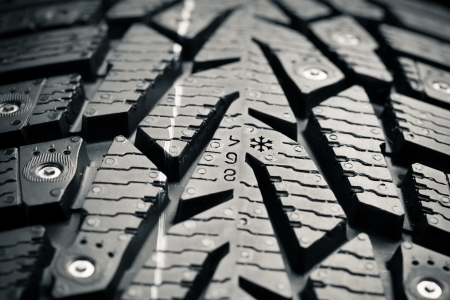 protector: protector and snow spikes of winter tire Stock Photo
