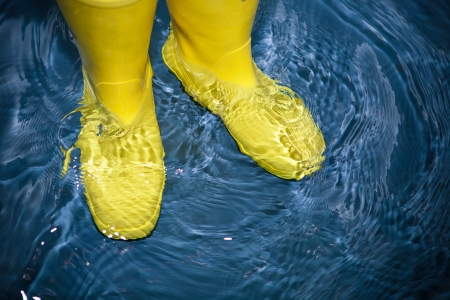 safety boots: rubber boots in the water Stock Photo