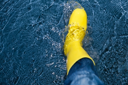 rubber boot splashing in the water photo